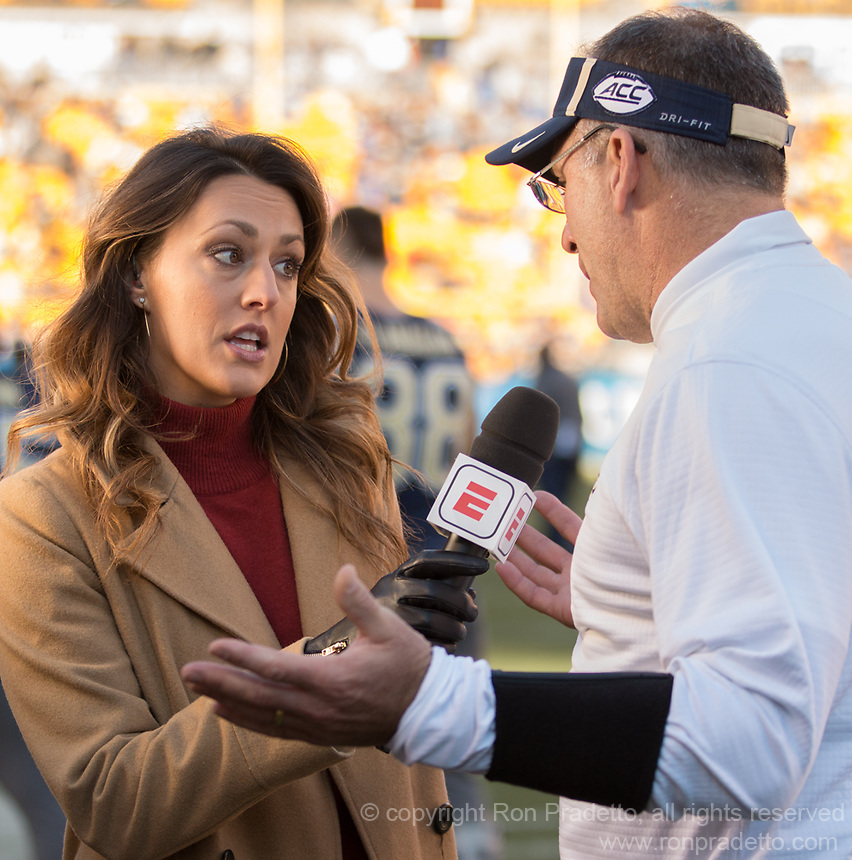 ESPN sideline reporter Allison Williams interviews Pitt Panther head coach Pat Narduzzi at halftime during which Narduzzi predicted an upset. The Pitt Panthers upset the undefeated Miami Hurricanes 24-14 on November 24, 2017 at Heinz Field, Pittsburgh, Pennsylvania.