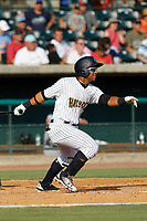 """Charleston Riverdogs designated hitter Frederick Cuevas (8) at bat during a game against the Hickory Crawdads at the Joseph P. Riley Ballpark in Charleston, South Carolina. For Sunday games, the Riverdogs wear their """"Holy City"""" uniforms in honor of the city's nickname. Hickory defeated Charleston 8-7. (Robert Gurganus/Four Seam Images)"""