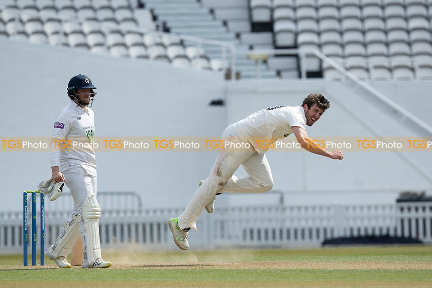 Jamie Overton of Surrey follows through as Liam Dawson backs up during Surrey CCC vs Hampshire CCC, LV Insurance County Championship Group 2 Cricket at the Kia Oval on 1st May 2021