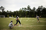 July 25, 2008. Durham, NC.. Started over 30 years ago, Beep Ball is baseball for the visually impaired. Played with an oversized softball that beeps, and bases that also make sound, the game has allowed people with varying degrees of visual impairment to participate in a team sport. All players are required to wear blacked out masks, to equalize the impairment and if the fielding team gets control of the ball before the hitting player reaches the base, an out is recorded. If the hitting player reaches the base first, a run is scored. There are only 2 bases, one to the left and one to the right, and the hitting player hears a tone after the hit is made, to add to the difficulty, telling them which base to run to.. A member of the Durham Sluggers prepares to hit the incoming beep ball.