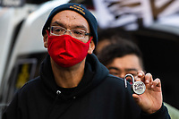 Protestors place locks with names of people killed by police in Minnesota on the fence outside the Hennepin County Government Center on Day One of the Derek Chauvin Trial on March 29, 2021 in Minneapolis, Minnesota, USA.  <br /> CAP/MPI/IS/CT<br /> ©CT/IS/MPI/Capital Pictures