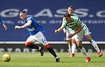 02.05.2121 Rangers v Celtic: Moi Elyounoussi rips Ryan Kent's shirt