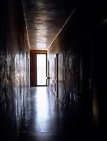 In the dark corridor linking the bedrooms in the children's wing four basins jut out pertly from the wall