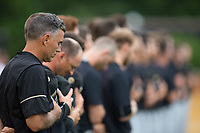 Wake Forest Demon Deacons head coach Tom Walter (16) and the rest of his team stand fir the National Anthem prior to the game against the West Virginia Mountaineers in Game Six of the Winston-Salem Regional in the 2017 College World Series at David F. Couch Ballpark on June 4, 2017 in Winston-Salem, North Carolina.  The Demon Deacons defeated the Mountaineers 12-8.  (Brian Westerholt/Four Seam Images)