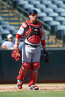Surprise Saguaros catcher Christian Vazquez #5, of the Boston Red Sox organization, during an Arizona Fall League game against the Phoenix Desert Dogs at Phoenix Municipal Stadium on October 18, 2012 in Phoenix, Arizona.  The game was called after eleven innings with a 2-2 tie.  (Mike Janes/Four Seam Images)