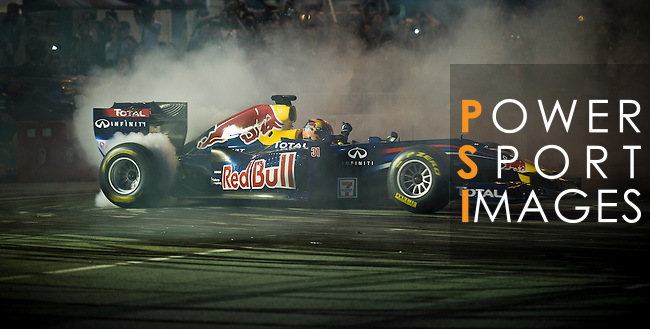 Red Bull Toro Rosso driver Jaime Alguersuari spins his Formula 1 car on Hong Kong's Lung Wo Road during the Red Bull Dragon Run 2011 in Hong Kong, China on the 18th June 2011.