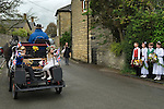 Charlton-on-Otmoor Oxfordshire, 1st of  May Day Celebrations. Children from the Church of England St Mary the Virgin Primary School with their May Queen and King process to the village church to have their May garlands blessed and put on display on the church Rood Screen. 2014.