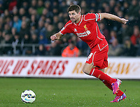 SWANSEA, WALES - MARCH 16: Steven Gerrard of Liverpool in action during the Premier League match between Swansea City and Liverpool at the Liberty Stadium on March 16, 2015 in Swansea, Wales
