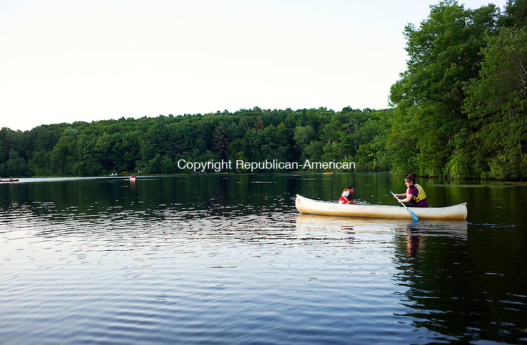 Watertown, CT- 19 August 2015-081915CM04- Caleb Richardson, 6, and his mom, Rhea Richardson of Waterbury go out on a canoe ride during family night at Camp Mataucha in Watertown on Wednesday, August 20th. 2015.  Christopher Massa Republican-American