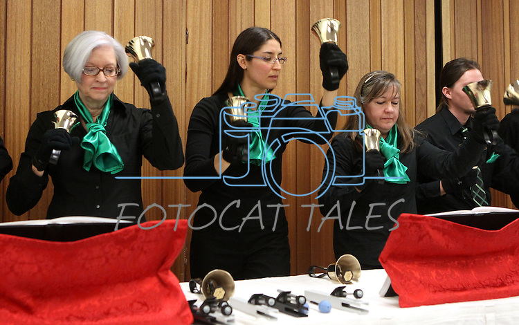 """The Tintabulations Handbell Ensemble performs during the """"Ringing in the Holidays"""" event at the Carson City Library on Saturday, Dec. 15, 2012..Photo by Cathleen Allison"""