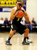 30 January 2010: University at Albany Great Danes' guard Derrek Tartt, a Freshman from Chicago, IL, in action against the University of Vermont Catamounts at Patrick Gymnasium in Burlington, Vermont. The Catamounts defeated the Danes 64-46 in the America East matchup. Mandatory Credit: Ed Wolfstein Photo