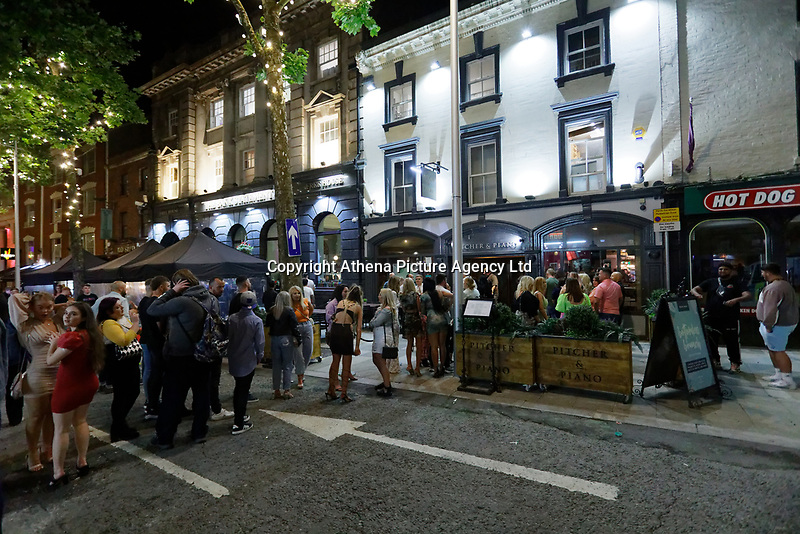 Pictured: People queue outside the Pitcher and Piano in Wind Street, Swansea, Wales, UK. Saturday 07 August 2021<br /> Re: Nightclubs have reopened this weekend as most Covid restrictions have come to an end in Wales, UK.<br /> Pubs and restaurants were allowed to open for certain periods, with safety measures in place unlike nightclubs.