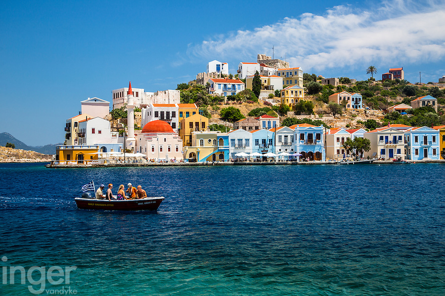 Tourists return from the Blue Grotto on Kastellorizo, Greece