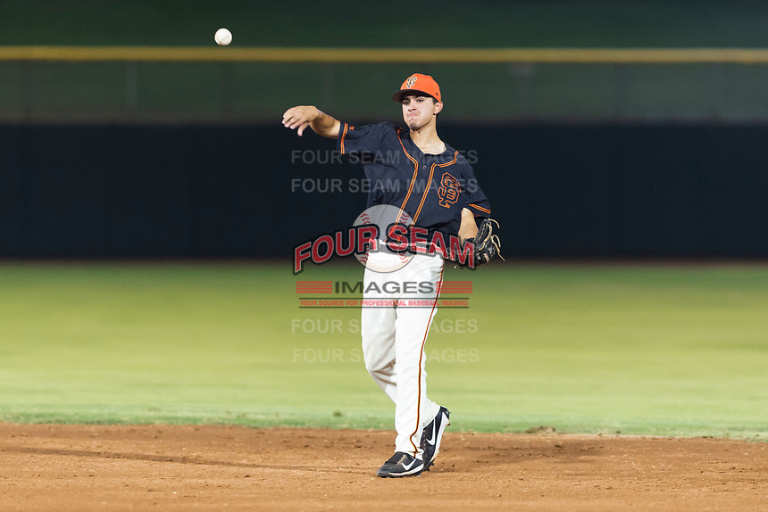 AZL Giants Black second baseman Marcos Campos (15) throws to first base during an Arizona League game against the AZL Rangers at Scottsdale Stadium on August 4, 2018 in Scottsdale, Arizona. The AZL Giants Black defeated the AZL Rangers by a score of 6-3 in the second game of a doubleheader. (Zachary Lucy/Four Seam Images)