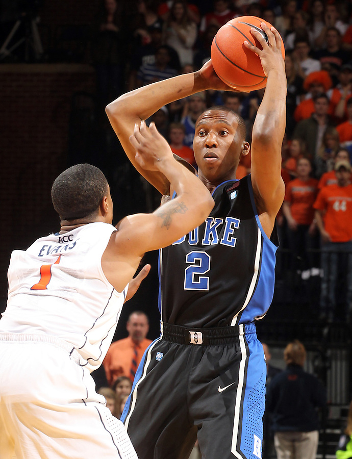 Feb. 16, 2011; Charlottesville, VA, USA; Duke Blue Devils guard Nolan Smith (2) handles the ball in front of Virginia Cavaliers guard Jontel Evans (1) during the second half of the game at the John Paul Jones Arena. The Duke Blue Devils won 56-41.  Credit Image: © Andrew Shurtleff