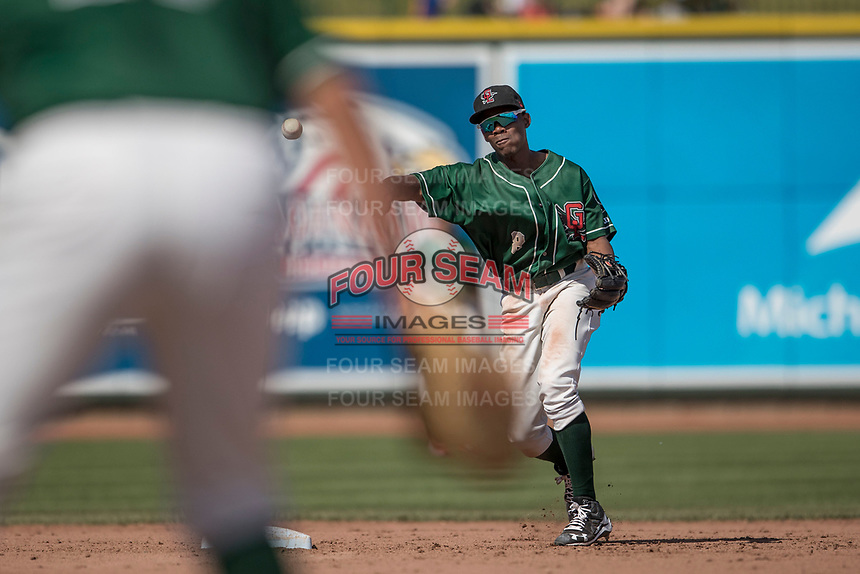 Great Lakes Loons shortstop Errol Robinson (8) makes a throw to first base against the Bowling Green Hot Rods during the Midwest League baseball game on June 4, 2017 at Dow Diamond in Midland, Michigan. Great Lakes defeated Bowling Green 11-0. (Andrew Woolley/Four Seam Images)
