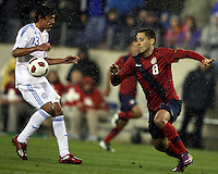 Clint Dempsey(8) of the USA MNT sends the ball past Enrique Daniel Vera(13) of Paraguay during an international friendly match at LP Field, in Nashville, TN. on March 29, 2011. Paraguay won 1-0.