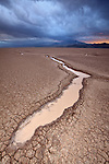 Water and ephemeral depressions in the playa of Red Lake in Arizona, USA