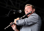 Michael Flatley plays a tune on flute at the official opening of the All-Ireland Fleadh 2017 in Ennis. Photograph by John Kelly.