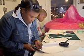 Memebers of Flamboyan carnival group prepare costumes  for the Notting Hill Carnival.