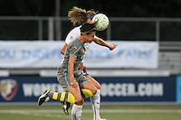 Philadelphia forward/midfielder, Veronica Boquete (21), challenges magicjack midfielder, Marian Dalmy (2) for a ball in the air.  With five different players scoring, the Philadephia Independence overpowered magicjack, 6-0 on June 18th at Widener University in Chester, PA.