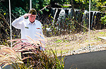 WATERTOWN CT 072427JS07  Rick Noble, Commander of VFW Post 5157 in Watertown, salutes after laying a wreath  during a dedication fo the Korean War Veterans Bridge along the Steel Brook Greenway in Watertown on Tuesday. <br /> Jim Shannon Republican American7