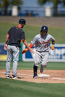 Detroit Tigers coach Gary Cathcart (left) congratulates Eliezer Alfonzo (53) after hitting a home run during a Florida Instructional League intrasquad game on October 17, 2020 at Joker Marchant Stadium in Lakeland, Florida.  (Mike Janes/Four Seam Images)