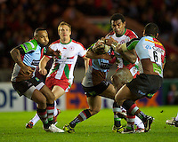 Seremaia Burotu of Biarritz Olympique is tackled by Maurie Fa'asavalu of Harlequins during the Heineken Cup match between Harlequins and Biarritz Olympique Pays Basque at the Twickenham Stoop on Saturday 13th October 2012 (Photo by Rob Munro)