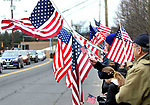 "WATERBURY CT. 31 December 2018-123118SV08-Flag wavers line East Main Street as the hearse carrying Zeqir ""Ziggy the Flag Man"" Berisha enters Calvary Cemetery in Waterbury Monday.<br /> Steven Valenti Republican-American"