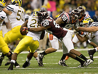 Alonzo Tweedy of Virginia Tech tackles Fitzgerald Toussaint of Michigan during Sugar Bowl game at Mercedes-Benz SuperDome in New Orleans, Louisiana on January 3rd, 2012.  Michigan defeated Virginia Tech, 23-20 in first overtime.