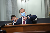 United States Senator John Thune (Republican of South Dakota) checks his watch during a United States Senate Committee on Commerce, Science, and Transportation oversight hearing to examine the Federal Communications Commission in Washington, DC on June 24, 2020. <br /> Credit: Jonathan Newton / Pool via CNP/AdMedia