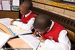 K-8 Parochial School Bronx New York Grade 3 mathematics lesson on measurement using rulers two boys at work at desks  horizontal