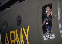 Alex Steelman, 11, a student from Alma, peers out of a window Thursday, June 10, 2021, in a Piasecki H-21 Shawnee helicopter as she and a large group of students tour the Arkansas Air and Military Museum in Fayetteville. The students are participants in Camp Airedale, a three-week summer camp focused on experiences and relationship building for students in the school district that features a field trip each week. Visit nwaonline.com/210611Daily/ for today's photo gallery.<br /> (NWA Democrat-Gazette/Andy Shupe)