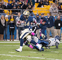 Pitt running back Isaac Bennett (34) runs for a touchdown. The Pitt Panthers defeated the Old Dominion Monarchs 35-24 at Heinz Field, Pittsburgh, Pennsylvania on October 19, 2013.