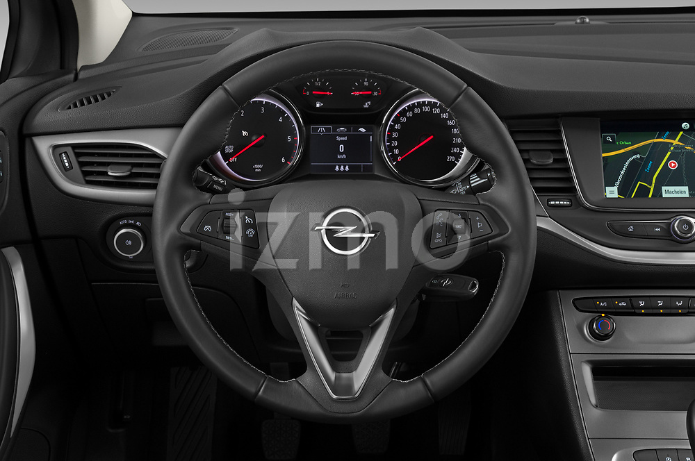 Car pictures of steering wheel view of a 2020 Opel Astra-Sport-Tourer Edition 5 Door Wagon Steering Wheel