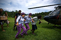 'Twin Teachers' Rian and Rossy prepare to hitch a ride from a Super Puma military helicopter to go to a remote village in Indonesia's Papua province to visit students from one of their schools. Since the early 1990s, twin sisters Sri Rosyati (known as Rossy) and Sri Irianingsih (known as Rian) have used their family inheritance to set up and run 64 schools in different parts of Indonesia, providing primary education combined with practical skills to some of the country's most deprived children.