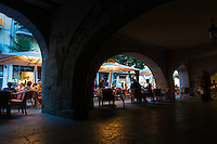 Archs in street cafe in Girona, Spain