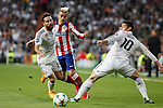Real Madrid's Daniel Carvajal and James Rodriguez and Atletico del Madrid´s Griezmann during quarterfinal second leg Champions League soccer match at Santiago Bernabeu stadium in Madrid, Spain. April 22, 2015. (ALTERPHOTOS/Victor Blanco)