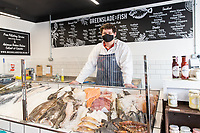 BNPS.co.uk (01202) 558833<br /> Pic: WillDax/BNPS<br /> <br /> There's a fishmonger's at Kingland <br /> <br /> A complex of ten small independent businesses that are not paying rent or business rates could hold the answer for saving the British high street.<br /> <br /> Kingland is an ambitious initiative aimed at breathing new life into the struggling town centre in Poole, Dorset, which people said had become like a 'ghost town'.<br /> <br /> The new development has been billed as a 'boutique shopping experience' and the owners of the small independents do not have to pay any rent or business rates for the first two years.<br /> <br /> The shops offer a diverse range with a fishmonger, zero waste grocery store, custom surfboard maker, coffee shop, gallery, restored furniture shop, fragrance shop, plant and interiors shop, design studio and a gin bar and shop.