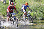 Les Basher (244) and Margot Harkness (50) going through the first ford. Mammoth Adventure MTB Ride, Nelson<br /> Photo: Marc Palmano/shuttersport.co.nz