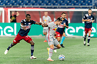 FOXBOROUGH, MA - AUGUST 29: Benjamin Mines #17 of New York Red Bulls on the attack as Cristian Penilla #70 of New England Revolution defends during a game between New York Red Bulls and New England Revolution at Gillette Stadium on August 29, 2020 in Foxborough, Massachusetts.