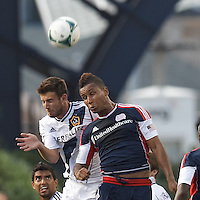 LA Galaxy defender Tommy Meyer (21) and New England Revolution midfielder Juan Agudelo (10) battle for head ball.  In a Major League Soccer (MLS) match, the New England Revolution (blue) defeated LA Galaxy (white), 5-0, at Gillette Stadium on June 2, 2013.