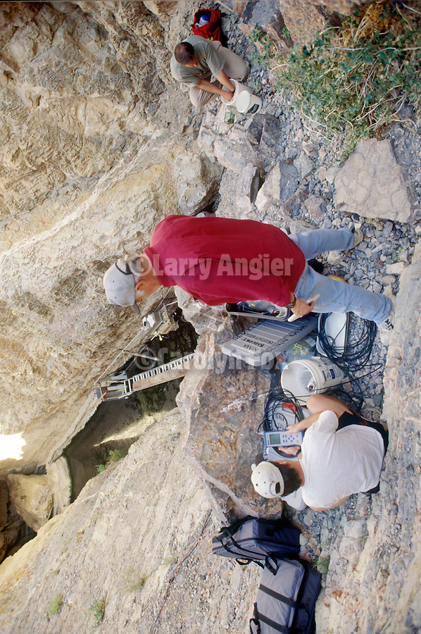 Biologies Dean Blinn, Kevin WIlson and David Herbst study the Devil's Hole Pupfish ecosystem, Death Valley National Park, Nev.