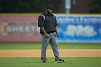 Umpire Drew Dune handles the calls on the bases during the Coastal Plain League game between the Wilson Tobs and the High Point-Thomasville HiToms at Finch Field on July 17, 2020 in Thomasville, NC. The Tobs defeated the HiToms 2-1. (Brian Westerholt/Four Seam Images)