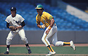 Oakland A's Reggie Jackson (9) in action during a game against the New York Yankees in the Bronx, New York. Reggie Jackson played for 21 years with 4 different teams and was inducted to the Baseball Hall of Fame in 2009..