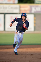 Lowell Spinners shortstop Korby Batesole (12) runs the bases during a game against the Vermont Lake Monsters on August 25, 2018 at Edward A. LeLacheur Park in Lowell, Massachusetts.  Vermont defeated Lowell 4-3.  (Mike Janes/Four Seam Images)
