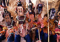 Masked Dogon Funerary dancers Bandiagara Escarpment Dogon Country Mali.