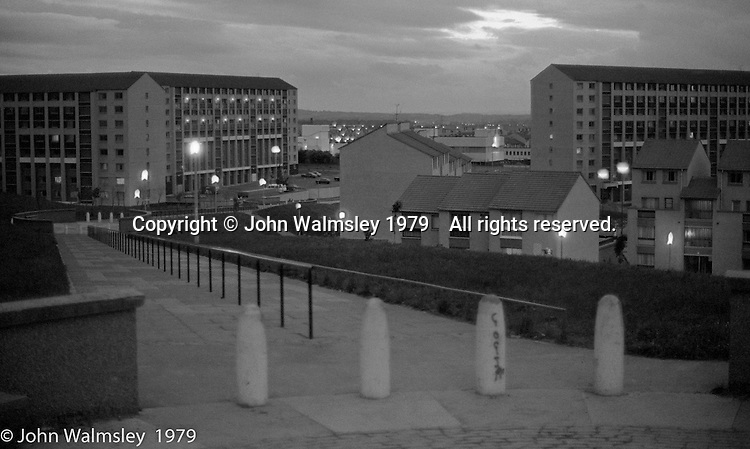 Dusk on the housing scheme, Wester Hailes, Scotland, 1979.  John Walmsley was Photographer in Residence at the Education Centre for three weeks in 1979.  The Education Centre was, at the time, Scotland's largest purpose built community High School open all day every day for all ages from primary to adults.  The town of Wester Hailes, a few miles to the south west of Edinburgh, was built in the early 1970s mostly of blocks of flats and high rises.
