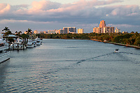 Ft. Lauderdale, Florida.  Setting Sun Illuminates Buildings behind Hugh Taylor Birch State Park and the Intracoastal Waterway.