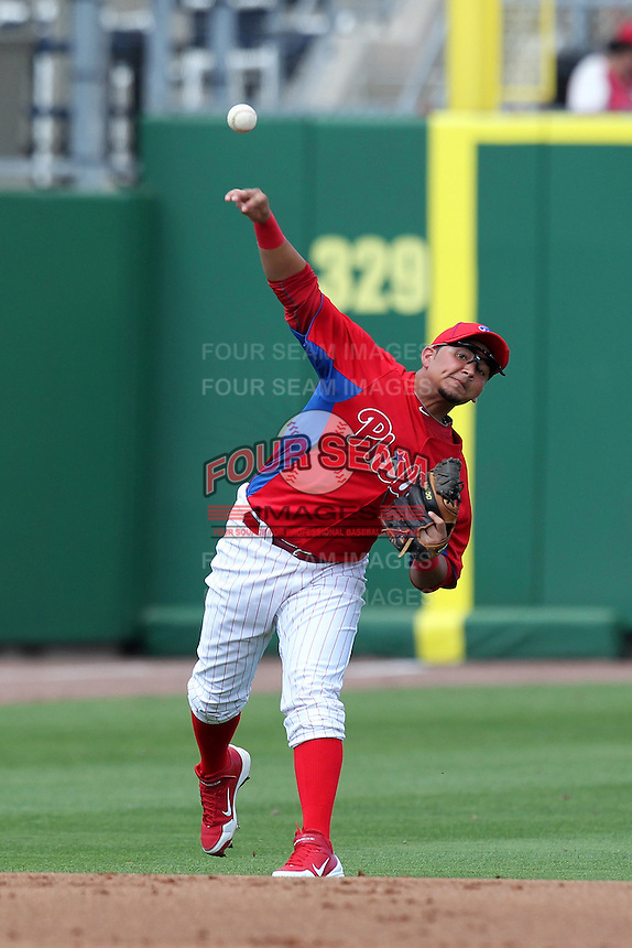 Philadelphia Phillies shortstop Freddy Galvis #13 throws to first during a scrimmage against the Florida State Seminoles at Brighthouse Field on February 29, 2012 in Clearwater, Florida.  Philadelphia defeated Florida State 6-1.  (Mike Janes/Four Seam Images)